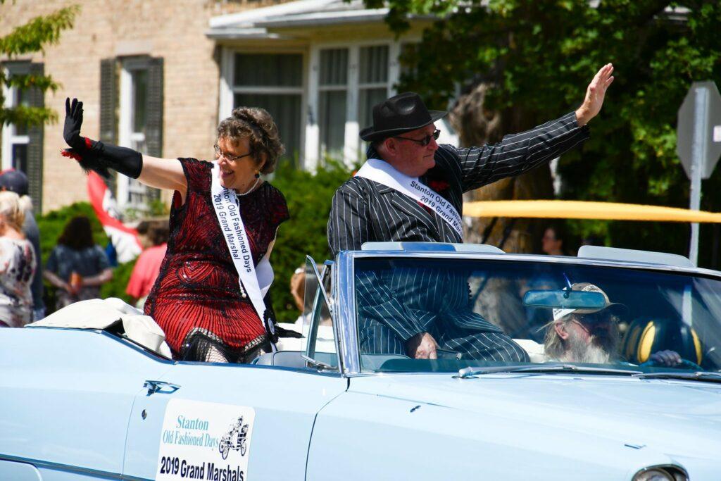 2019 Grand Marshals riding and waving in parade
